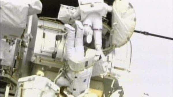 This image taken from NASA television shows astronauts Andrew Feustel, top, and Mike Fincke exiting the hatch on the International Space Station at the start of the second spacewalk early Sunday May 22, 2011. (c) AP Photo/NASA