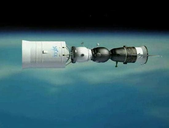 A propulsion and habitation module at left, linked up with a Soyuz spacecraft at right to create a complex designed for flying around the moon and back to Earth. Artist impression (c) Space Adventures