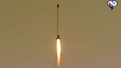 Screen from Iran's Arabic-language TV channel Al-Alam shows the launch of Iran's Rassad-1 satellite. (c) AFP/Al-Alam