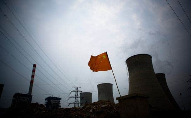 A Chinese flag flies in front of a coal-fired power plant in Tianjin, China. China is the world's biggest user of coal, and the world's biggest emitter of carbon. (c) Jeff Hutchens/Getty Images