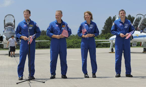 Joining Ferguson (left in photo) for the 12-day STS-135 mission to the International Space Station are pilot Doug Hurley (second left), and mission specialists Sandy Magnus and Rex Walheim. (c) NASA