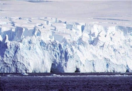 Masses of ice rise up to 120 feet above the water level near the Southern Shetlands archipelago in Antarctica during the southern hemisphere's summer season. (c) AP