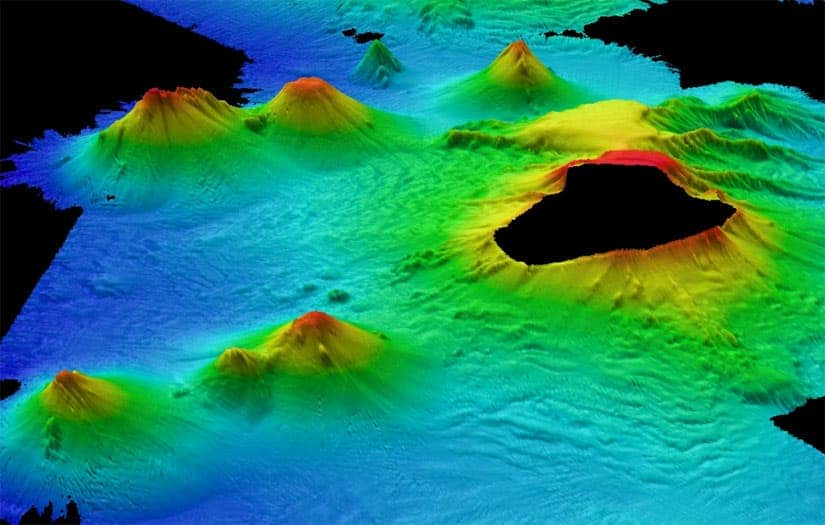 Underwater volcanoes beneath the Antarctic seas. The peak in the foreground is thought to be the most active, with eruptions in the past few years. (c) British Antarctic Survey