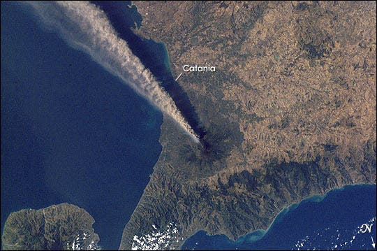 Mt. Etna gushing plume from an eruption in 2001, as seen from an image captured in space by the International Space Station. (c) NASA