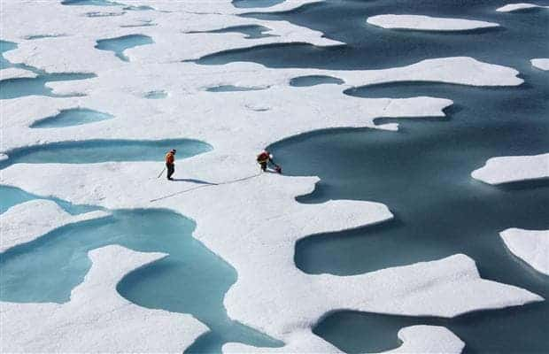 Undated handout photo shows NASA scientists collecting data from thawing Arctic ice during the U.S. agency's ICESCAPE mission in July. (c) Kathryn Hansen, NASA