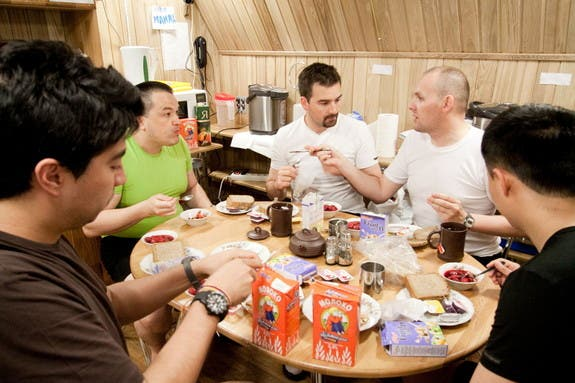 The Mars500 crew share a meal together. Curiously enough, no space food was served and cereal isn't floating either. (c) ESA/Mars500 crew