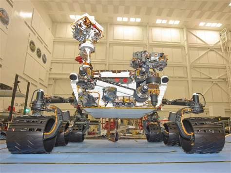 NASA's Mars Science Laboratory as seen during a final testing at the Jet Propulsion Laboratory. Curiosity is now deep in space on route to Mars. (c) NASA