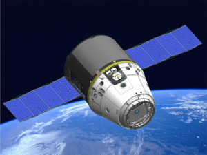 Artists conception of SpaceX's Dragon spacecraft in orbit. (c) NASA