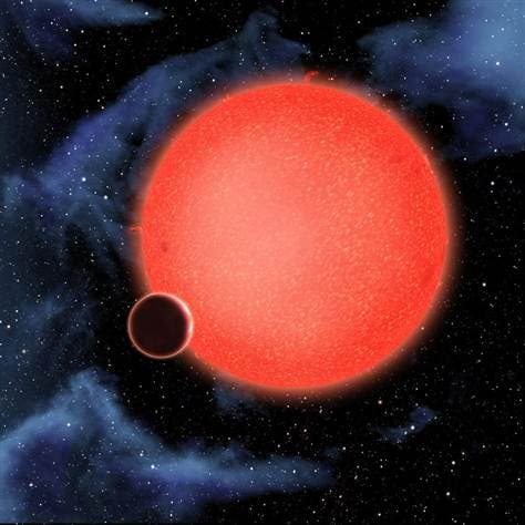 "Artist impression of the ""water-world"" GJ1214b, orbiting around its red-dward star. The planet represents a whole new type of exoplanet, like nothing ever observed so far in known planetary systems. (c) NASA"