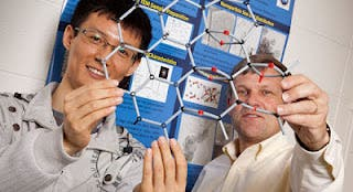 Physics Professor Michael Weinert and engineering graduate student Haihui Pu display the atomic structure on GMO. (Photos by Alan Magayne-Roshak)