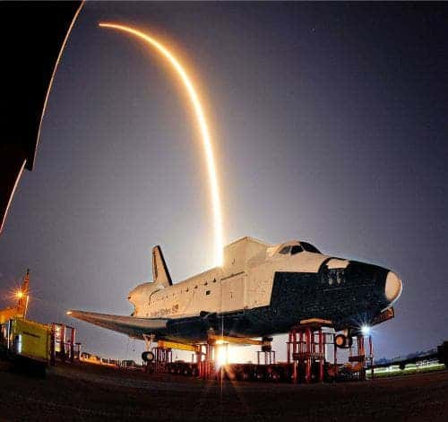 The Private Company SpaceX launch of its Falcon 9 rocket and a unmanned Dragan capsule turns night into day during liftoff from a Cape Canaveral launch pad early Tuesday as it streaks over a model of NASA's space shuttle at the Kennedy Space Center, heading for a rendezvous with the International Space Station, opening a new era of dollar-driven spaceflight. (AP Photo/Florida Today, Craig Rubadoux)  Photo: Ap/getty / SL