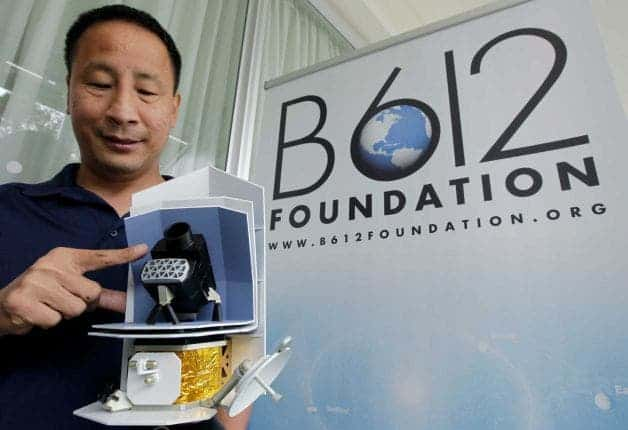 Ed Lu, Chairman of the B612 Foundation, shows the telescope of a model of the Sentinel Space Telescope during a news conference in San Francisco, Thursday, June 28, 2012. The group of ex-NASA astronauts and scientists on Thursday announced they plan to launch a privately-funded space telescope to search for small asteroids that may pose a danger to Earth. Photo: Paul Sakuma / AP