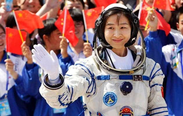 Liu Yang, China's first female astronaut, waves during a departure ceremony at Jiuquan Satellite Launch Center, Gansu province, June 16, 2012. (c) JASON LEE / REUTERS