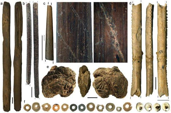 Objects found in the archaeological site called Border Cave include a) a wooden digging stick; b) a wooden poison applicator; c) a bone arrow point decorated with a spiral incision filled with red pigment; d) a bone object with four sets of notches; e) a lump of beeswax; and f) ostrich eggshell beads and marine shell beads used as personal ornaments. (c) Francesco d'Errico and Lucinda Backwell.