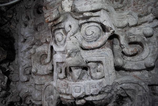 One of the many Mayan stucco masks uncovered at the newly discovered temple. It shows the Maya sun god as a shark-man. (c) Edwin Román, Brown University