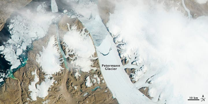 Satellite photo of the Petermann glacier before the giant iceberg broke off the ice sheet. Notice a significant crack shaped like a circle arc. (c) NASA
