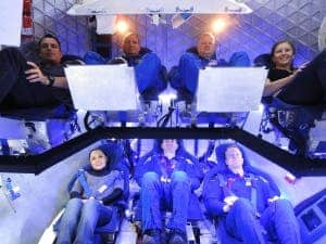 SpaceX Dragon crew in evaluation test. (c) SpaceX