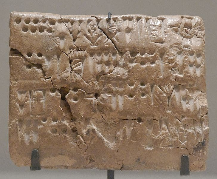 Tablet with numeric signs and script. From Teppe Sialk, Susa, Uruk period (3200 BC to 2700 BC). Department of Oriental Antiquities, Louvre.