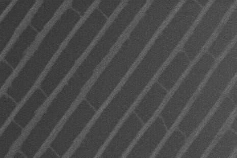 Nanometer-scale grooves on the surface of the shingles.