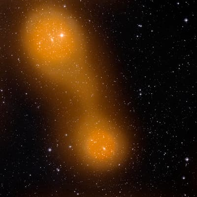 Galaxy clusters Abell 399 (lower centre) and Abell 401 (top left). The galaxy pair is located about a billion light-years from Earth, and the gas bridge extends approximately 10 million light-years between them. (c) ESA
