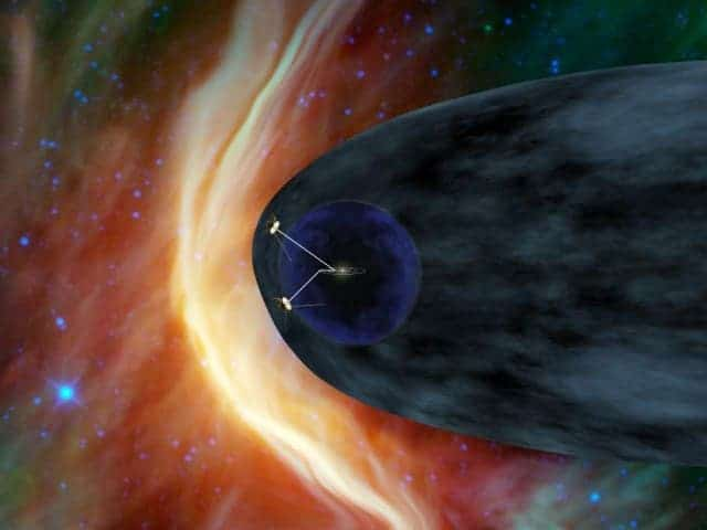 This artist's concept shows NASA's two Voyager spacecraft exploring a turbulent region of space known as the heliosheath, the outer shell of the bubble of charged particles around our sun. After more than 33 years of travel, the two Voyager spacecraft will soon reach interstellar space, which is the space between stars.  (c) NASA