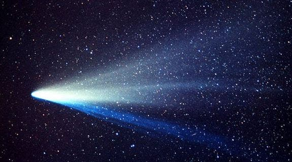 Photograph of Comet West, one of the greatest comets of all-time, taken by an amateur astronomer. (c)  John Laborde