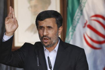 Iranian President Mahmoud Ahmadinejad waves as he speaks during in a rally organized by Lebanon's Hezbollah in Bint Jbeil
