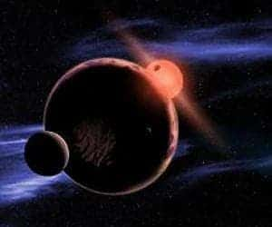 An artist's impression of an Earth-like planet with two moons orbiting around a red dwarf star. (c) David A. Aguilar (CfA).