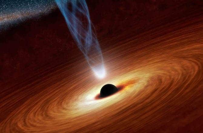 Artist's impression of a spinning supermassive black hole with a surrounding accretion disk and relativistic jets. (c) NASA/JPL