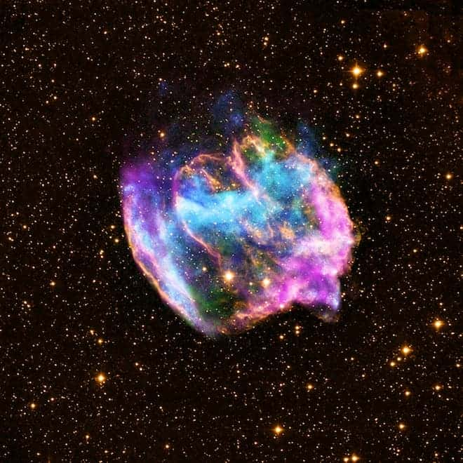 This highly distorted supernova remnant may contain the most recent black hole formed in the Milky Way galaxy. The composite image combines X-rays from Chandra (blue and green), radio data from the Very Large Array (pink), and infrared data from the Palomar Observatory (yellow). (c) NASA