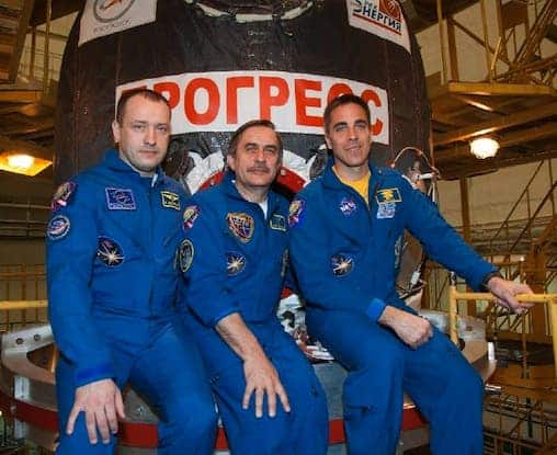 Flight Engineer Alexander Misurkin (left), Soyuz Commander Pavel Vinogradov (center) and Flight Engineer Chris Cassidy of NASA pose for pictures in front of the ISS Progress 51 cargo ship being prepared for launch to the International Space Station on Friday. (Photo: Victor Zelentsov/NASA)