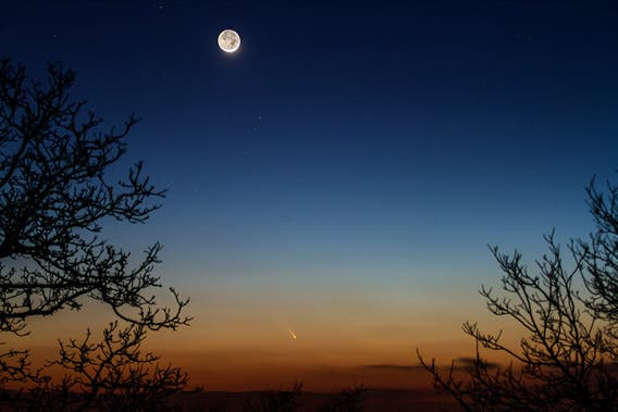 A time exposure photo of the comet by an unusually bright moon caught by the same  Jean-Luc Dauvergne.