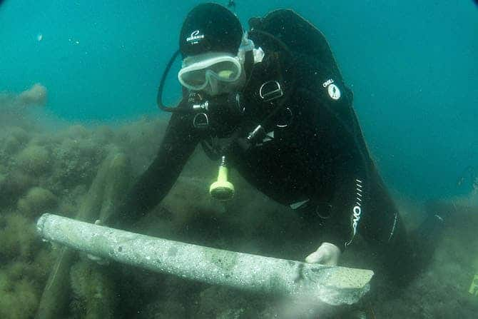 Chris Brandon of the ROMACONS project collects a sample of ancient Roman concrete drilled from a breakwater in Pozzuoli Bay, near Naples, Italy.