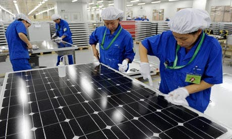 (c) Employees inspect solar panels at a factory in Hangzhou, Zhejiang province. Photograph: Lang Lang/Reuters