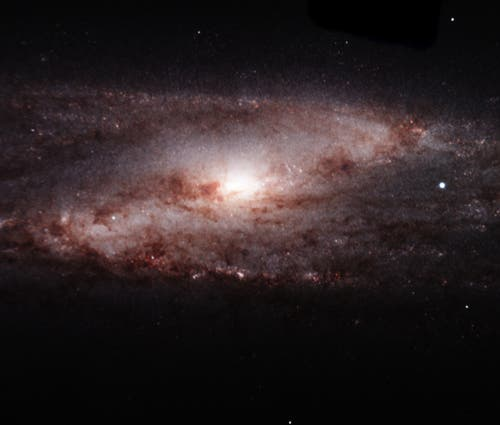 In this near-infrared image, FLAMINGOS-2 peered deep into the heart of spiral galaxy NGC 253, which lies about 11.5 million light-years nearby in the constellation of Sculptor. The new instrument captured an intricate whirlpool of dust spiraling in to a diffuse nuclear region, where violent star formation may be occurring around a supermassive black hole. The instrument also imaged a dusting of star forming sites in its spiral arms. Field of view: 4.8 x 4.1 arcmin. Credit: Gemini Observatory/AURA