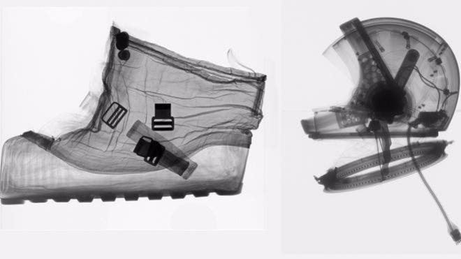 On lefthand side, an overshoe designed to be worn by astronauts over Apollo spaceboots for moon walks. On the righthand side, a 1964 helmet - you can see various mechanical parts fitted inside like ball bearings in the neck ring that allowed flexibility. (c) AP