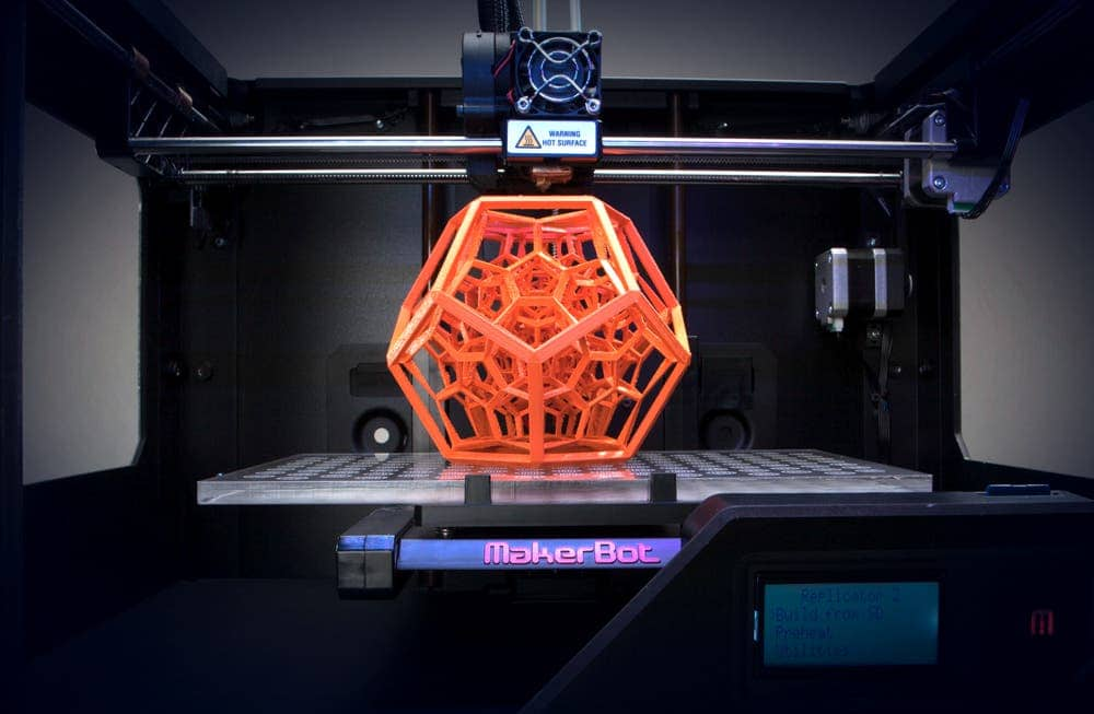 An intricate 3D object made with a MakerBot 3D printer, a solution for home users. (c) MakerBot