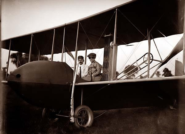 Here we present a stunning image of Katharine Wright, wearing a leather jacket, cap, and goggles, aboard the Wright Model HS airplane with Orville. It was taken in 1915.