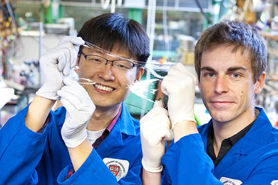 Jeong-Yun Sun (left) and Christoph Keplinger show off an ionically conductive material that is very stretchy and completely transparent. Photo by Eliza Grinnell/SEAS Communications