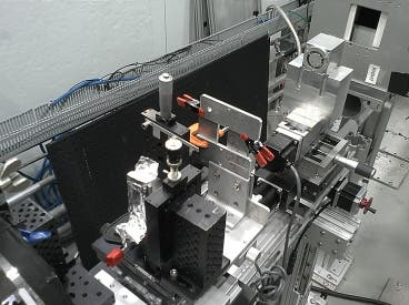 The team's small prototype neutron microscope is shown set up for initial testing at MIT's Nuclear Reactor Laboratory. The microscope mirrors are inside the small metal box at top right.
