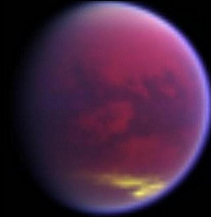 False-color images, made from data obtained by NASA's Cassini spacecraft, shows clouds covering parts of Saturn's moon Titan in yellow.