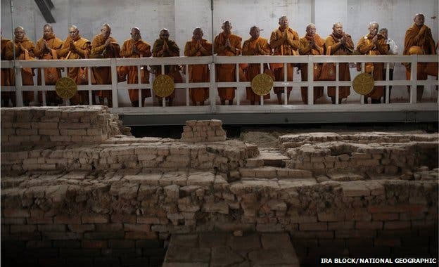 Pilgrims and monks meditating while archaeologists excavated the site at Lumbini.