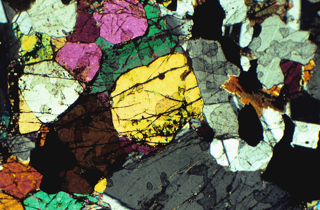 Mycroscopic image of crystals, as seen through a geological microscope.