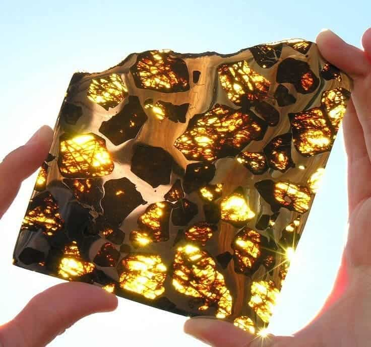 Meteorite, pallasyte, olivine... a magnificent display of crystals - a geologist's wet dream.