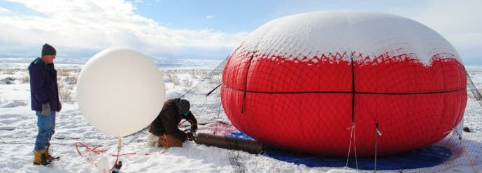NOAA researcher Bryan Johnson (left) and University of Colorado, Boulder, researcher Detlev Helmig (right) prepare a tethered balloon that will collect air samples above Utah's Uintah Basin. Photo: Chelsea Thompson