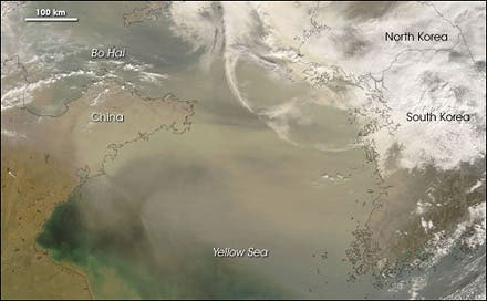 "In March 2008, a typical ""yellow dust"" plume from the Gobi Desert blew eastward over the Beijing region. Photo: NASA/Jeff Schmaltz, MODIS Rapid Response team"