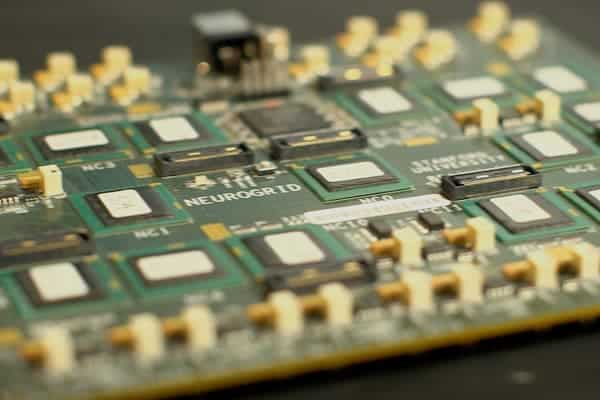 The Neurogrid circuit board can simulate orders of magnitude more neurons and synapses than other brain mimics on the power it takes to run a tablet computer. Photo: Stanford