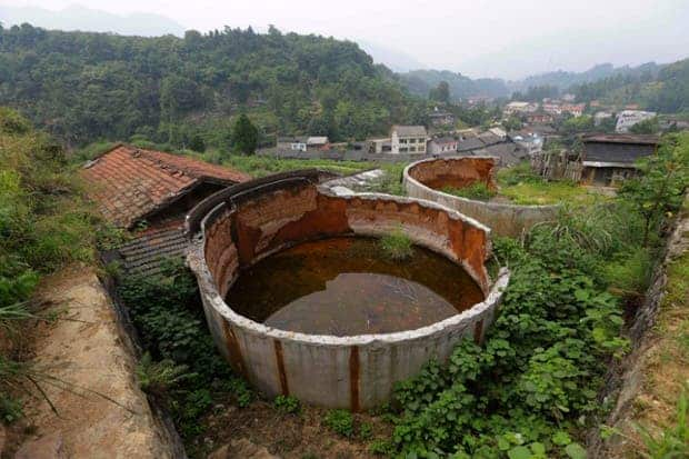 Disused tanks at a closed realgar mining plant  around Heshan. The plant was finally closed in 2011 following massive poisoning of the village.