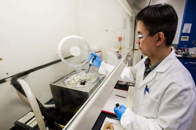 NREL Senior Scientist Kai Zhu prepares a perovskite solar cell in his lab. Photo: NREL