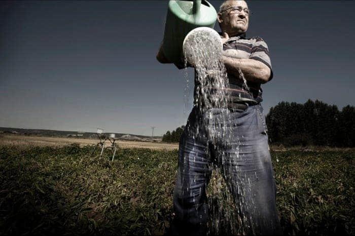 Farmer, water by Javier Arcenillas